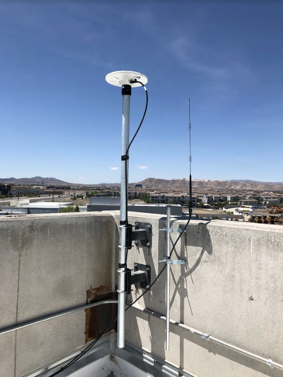 A Trimble Zephyr antenna mounted on a rooftop